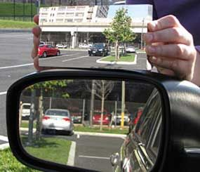 A standard left side mirror is at the top of the photo, with the Hicks design at the bottom. (Photo Drexel University)