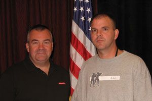 """Ed Hinchey (left), Armor Technical Specialist and Law Enforcement Liaison for Safariland, pictured with Bakersfield Police Officer Dennis Eddy at a ceremony held in Eddy's honor during the Street Survival Seminar in Anaheim, Calif. in September 2008. Officer Eddy returned to full duty after he was struck by gunfire in a gang-infested neighborhood in southeast Bakersfield, Calif. Read Officer Eddy's story, Putting a name and a face on UCR stats, where he says: """"Vest up!"""" (Photo by Doug Wyllie/PoliceOne)"""