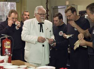 AP Photo/Brian Bohannon'KFC Colonel' look-alike Bob Thompson shares a meal with Garfield Park firefighters Tuesday to celebrate the marketing deal.