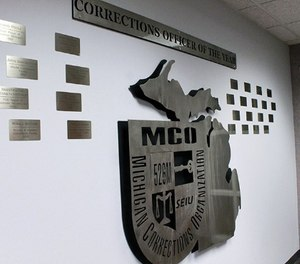 Each Michigan Department of Corrections Officer of the Year now gets special recognition on a wall at Michigan Corrections Organization's office. (Photo/MCO)