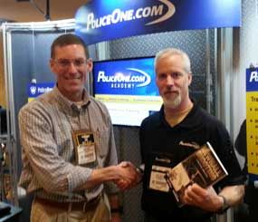 Mike Wood (left) pictured with Doug Wyllie at the PoliceOne booth at SHOT Show 2014. (Photo/PoliceOne)