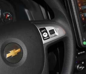 My favorite feature on display from General Motors and Motorola at APCO 2011, is decidedly low tech — the push-to-talk button on the steering wheel. (PoliceOne Image)