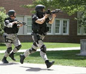 "Police officers from the Omaha Emergency Response Unit conduct training for a possible ""Active Shooter"" on the campus of the University of Nebraska at Omaha, in Omaha, Neb., Wednesday, July 11, 2007.   (AP Photo/Nati Harnik)"