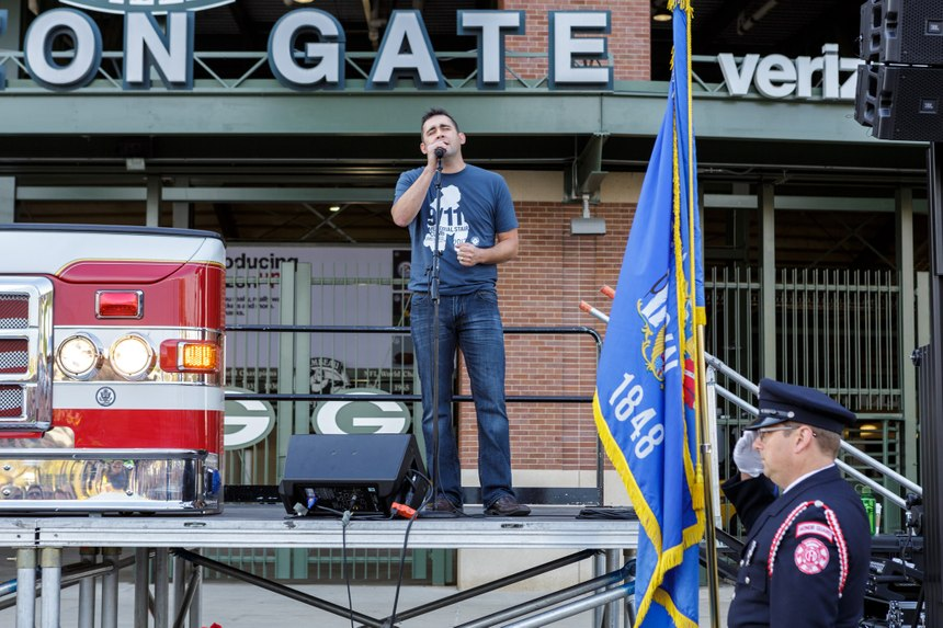Paul Cummings, a firefighter and singer/songwriter sings the national anthem. (Photo courtesy of Pierce Manufacturing)