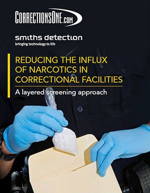 Reducing the influx of narcotics in correctional facilities, a layered screening approach (uniformed officer with gloves on places a baggie of white powder in an evidence folder)