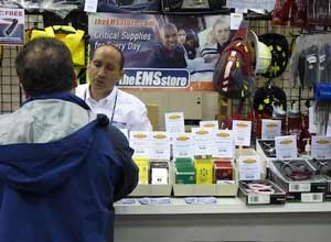 Photo Rick Markley Ron Sigismonti greets customers to the EMS Store booth at FDIC.