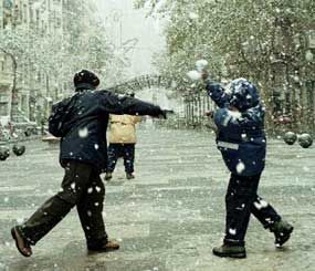 You come across a group of juveniles throwing snowballs at passing cars in the street. What do you do? (AP photo)