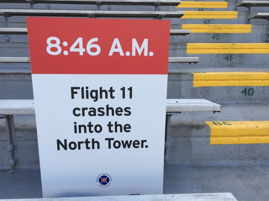 Signs throughout the stadium were a solemn reminder of why we were climbing: to remember. (Photo by Greg Friese)