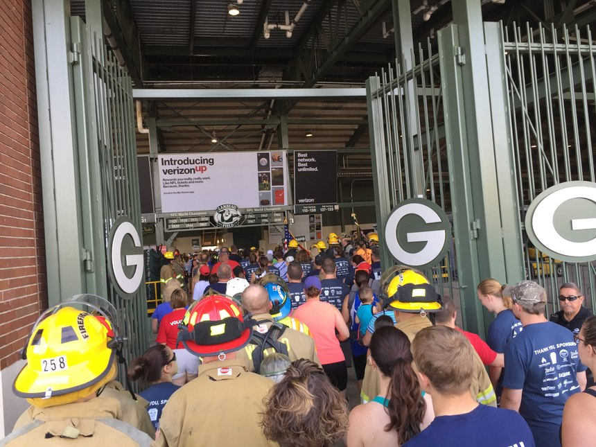 The first wave of participants enters the stadium. (Photo by Greg Friese)