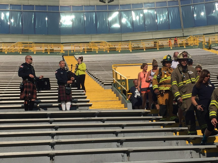 A drummer and bag pipe player led climbers into the stadium. (Photo by Greg Friese)