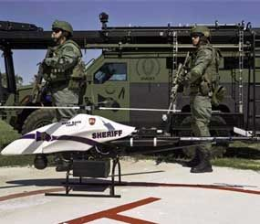 This September 2011 file photo provided by Vanguard Defense Industries, shows a ShadowHawk drone with Montgomery County, Texas SWAT team members. (AP Image)