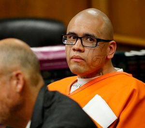 Michael Mejia, 26, shown with defense attorney Paul J. Cohen, listens to District Attorney Garrett Dameron speak about his pursuit of the death penalty during a pre-trial hearing at Superior Courthouse in Norwalk, Calif., on Feb. 16, 2018. (Allen J. Schaben/Los Angeles Times/TNS)