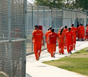 Inmates walk through the yard at the Lerdo jail facility in Bakersfield in 2014. A two-hour riot broke out there this week, leaving four inmates hospitalized. (Al Seib/Los Angeles Times/TNS)