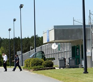 Prison officials enter and exit Lanesboro Correctional Institution in Polkton, N.C. (John D. Simmons/Charlotte Observer/TNS)