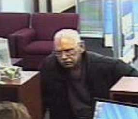 This Feb. 9 surveillance photo provided by the FBI shows 73-year-old Walter Unbehaun, an ex-convict from Rock Hill., S.C., during a bank robbery in Niles, Ill. (AP Image)