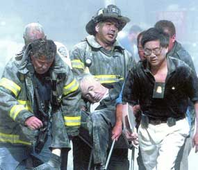 FBI ASAC Wesly Wong (right) and a group of FDNY firefighters were found the very first listed victim of 9/11 — Father Mychal Judge, the beloved Chaplain of the FDNY.