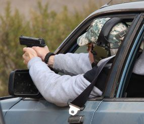 During my most recent range training exercises, the challenge was to get accurate, threat-stopping shots on target as quickly as possible from within the confined space of a compact car.  I did this training using sighted fire.  (PoliceOne Image)