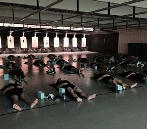 Recruits from the Des Moines Police Academy practice yoga as part of their academy curriculum. (Photo/American Military University)
