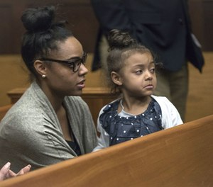 Shayanna Jenkins Hernandez, fiancee of former New England Patriots tight end Aaron Hernandez, sits in the courtroom with the couple's daughter during jury deliberations in Hernandez's double-murder trial at Suffolk Superior Court in Boston, Wednesday, April 12, 2017. (Keith Bedford/The Boston Globe via AP, Pool)