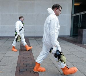 Firefighters in protective clothing prepare to enter the U.S. Courthouse in Philadelphia Wednesday, Feb. 20, 2013. The second floor of the federal court building was evacuated Wednesday after authorities found a letter containing a threat about anthrax. (AP Photo/Matt Rourke)