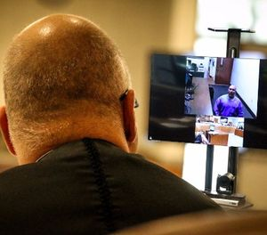 Kern County Superior Court Judge David Wolf speaks with an inmate at Pelican Bay State Prison, 600 miles away via an Oct. 16 video arraignment at Delano Prison Court (illustration). (Photo/Ike Dodson)