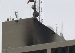 The charred wall near the helipad atop Spectrum Health Butterworth Hospital is shown in Grand Rapids, Mich., May 29, 2008. A medical helicopter crashed on the roof of the hospital, catching fire moments after the two people on board escaped with minor injuries, a fire official said. (AP Photo/Jim Harrington)