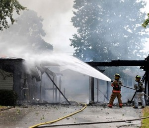 There are several toxic substances and carcinogens firefighters need to be aware of and protect against present in smoke. (Photo/USAF)