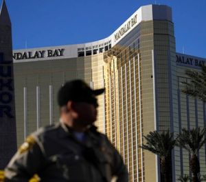 In this Oct. 3, 2017 file photo, a Las Vegas police officer stands by a blocked off area near the Mandalay Bay casino in Las Vegas. (AP Photo/John Locher, File)
