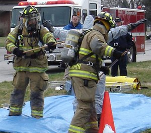 While firefighter attitudes were overwhelmingly favorable toward cleaning gear (knowledge), their actual decontamination and cleaning behaviors (doing) did not follow at the same level. (Photo/DoD)