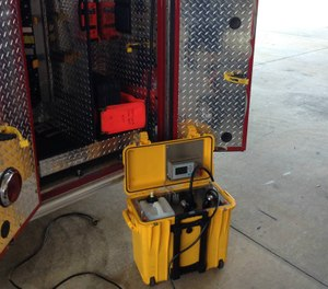 Made in Winter Park, the 48-pound unit is self-contained in a plastic box and can treat up to a 5,000-cubic-foot space. Set inside a rescue unit with spray nozzle extended, it mists up the interior in a few minutes. (Photo/Aeroclave)