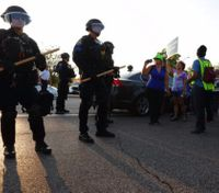 Protesters march in St. Louis suburb over fatal OIS