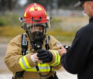 Before looking at the other features of a firefighting glove, pay attention to getting the glove that fits you just right, because the glove that fits best is going to perform best. (Photo/USAF)