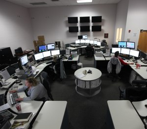 """Communications center consolidation can drive a significant sense of loss of ownership, a dissociation with the new communication center, an """"us versus them"""" attitude and a sense of mistrust. (Photo/USMC by Sgt. Thomas J. Griffith)"""