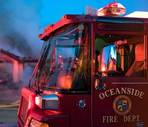 An Oceanside Fire Dept. firefighter was inspecting a bedroom of a burning home when a man jumped out and swung a knife at him. (Photo/OFD)