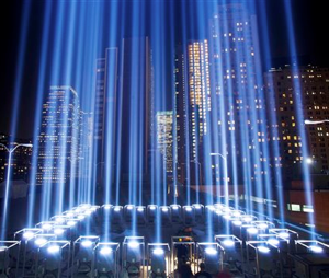 In this Sept. 10, 2013 file photo, the Tribute in Light rises above buildings during a test in New York. While the plaza at the National September 11 Memorial and Museum will be closed to the public, during the September 11 commemoration ceremony and much of the rest of the day, it will be open from 6 p.m. to midnight for those who want to pay respects and view one of the anniversary's most evocative traditions, the twin beams called the Tribute in Light. (AP Photo/Mark Lennihan, File)
