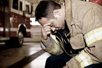 A firefighter feels the stress. (Image courtesy of iStock)