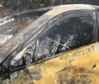 Firefighters help rescue woman from burning car
