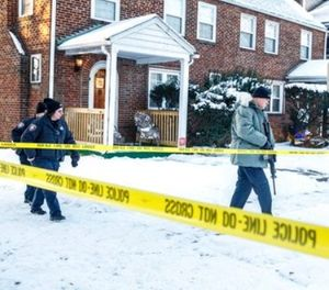Police investigate the scene after Deputy U.S. Marshal Christopher David Hill was killed when a gunman opened fire on law enforcement officers serving an arrest warrant inside a home earlier in the area, Thursday, Jan. 18, 2018, in Harrisburg, Pa. (Dan Gleiter/PennLive.com via AP)