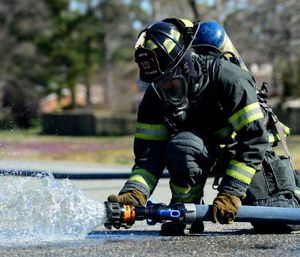 Water is our best defense against the heat release rates and energy production that we face with fires, and having a hand line that is flowing the right amount of water and at the right pressure is paramount. (Photo/USAF)