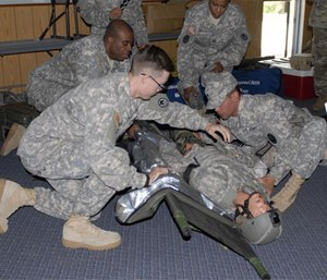 Soldiers learn combat casualty care and how to apply a tourniquet. (Photo by Army National Guard Sgt. Ruth McClary)