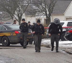 Authorities investigate the scene of a shooting where two Westerville, Ohio, police officers were shot and killed responding to a hang-up 911 call, on Saturday, Feb. 10, 2018. (Tom Dodge/The Columbus Dispatch via AP)