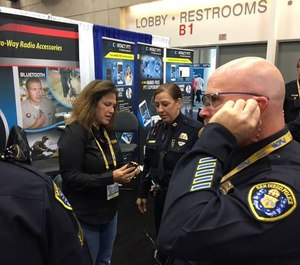 You can feel and hear the difference of these earpieces. An officer tries out Earphone Connection at a trade show. (photo/Earphone Connection)