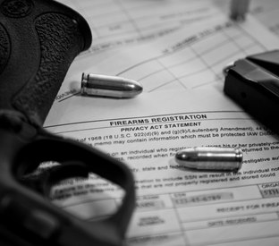 What should EMS providers consider before carrying a concealed weapon on duty?