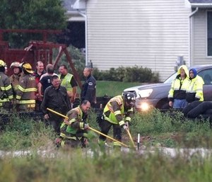 A boy was rescued from a storm sewer after a firefighter spotted his finger poking out of a manhole cover. (Photo/AP)