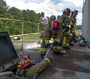 Rescuing a downed firefighter from an involved structure is difficult even with the proper training, but without any form of training, it can quickly turn into a disaster. (Photo/USAF)