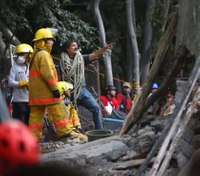 Workers dig through collapsed buildings as Mexico quake kills 225