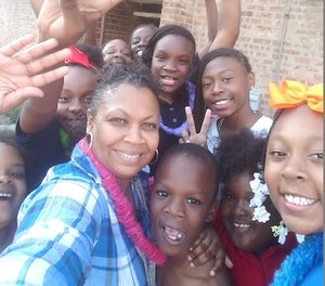 Officer Jennifer Maddox with some of the Future Ties children (Image/Maddox)