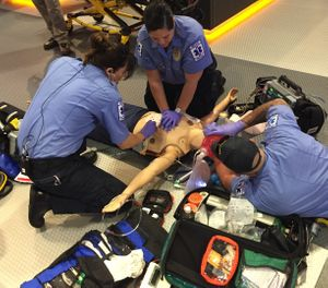 EMS personnel complete a hands-on training simulation on a protocol update. (Photo/Greg Friese)