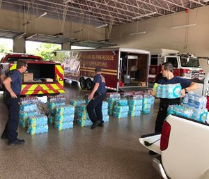 For first responders, jumping from one disaster to the next is no easy task – especially when their own homes may be experiencing similar flooding and destruction. (Photo/Greater Naples Fire District)