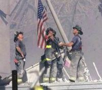 Man in iconic 9/11 photo sues FDNY for racial discrimination